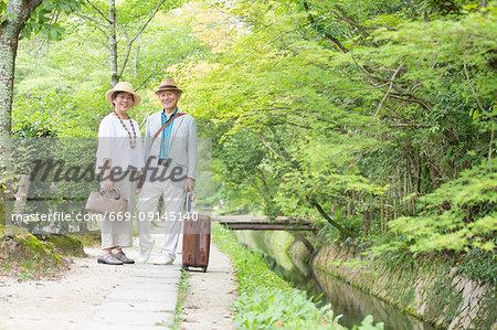 Senior couple looking at camera