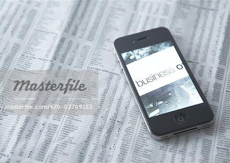 Smartphone and newspaper