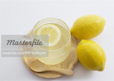 A glass of hot lemon drink