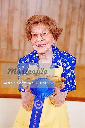 Woman holding her award winning pie