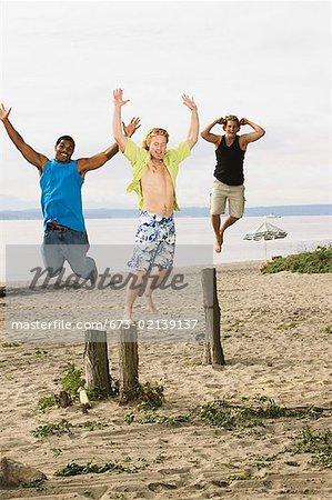 Men leaping off tree stumps