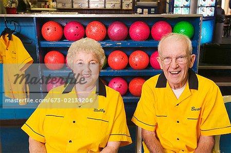 A senior bowling couple