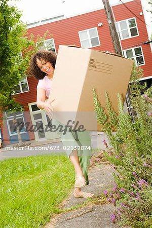 Woman dropping big moving box