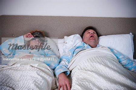 Woman awakened by snoring husband