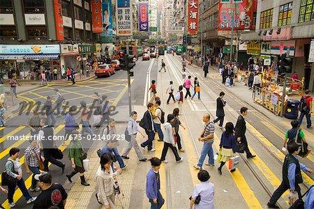 Crowded crosswalk on Hong Kong street