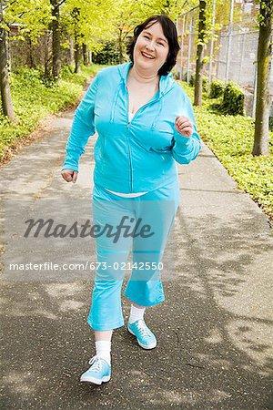 Woman power walking outdoors