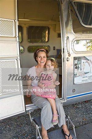 woman and girl in door of camper