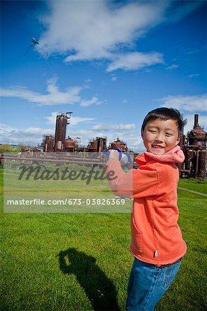 boy flying kite at gasworks park