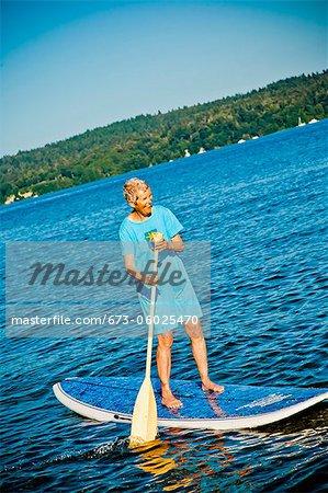 Senior woman on paddle board