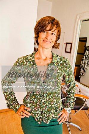 Beautician standing in beauty salon
