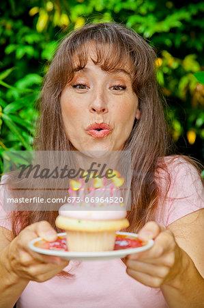 Woman with birthday cupcake