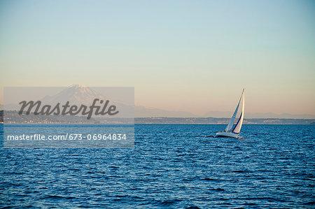 Mt. rainier behind sail boat on puget sound
