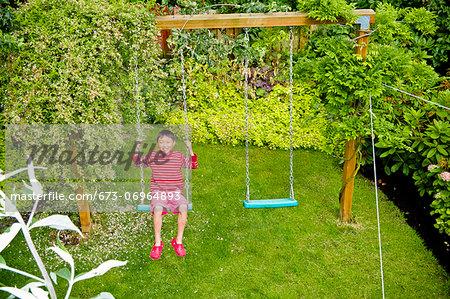 Boy on backyard swing