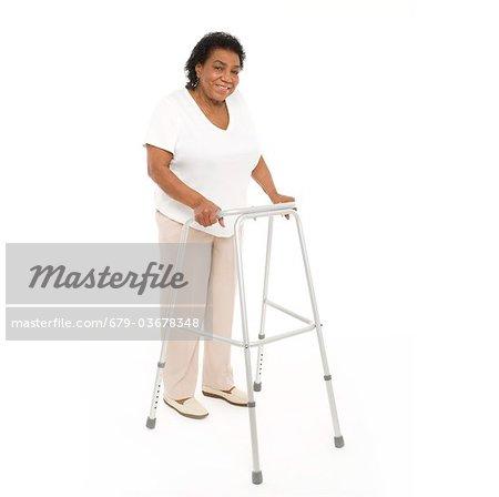 Woman using a walking aid.