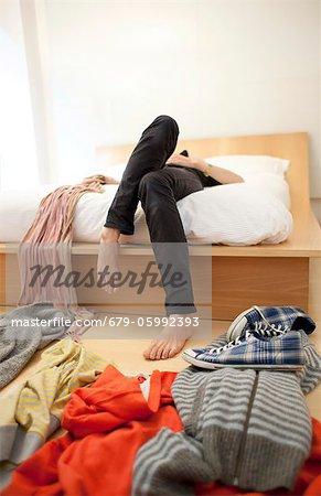 Woman's untidy bedroom.