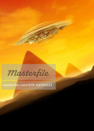 UFO over the pyramids, computer artwork.