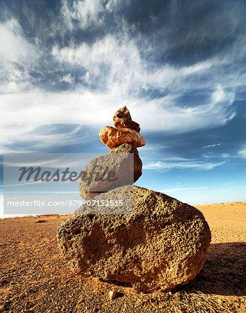 Balancing stones in a desert.