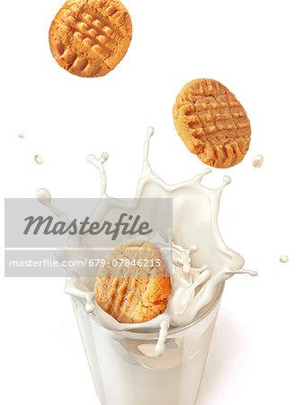 Biscuits splashing into milk, computer artwork.