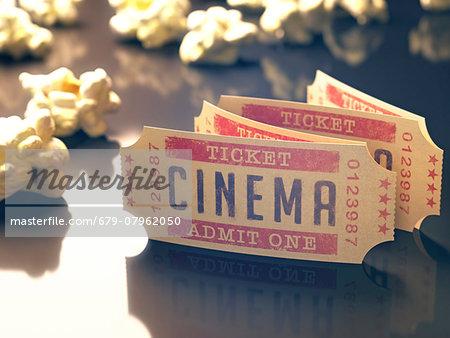 Cinema tickets and popcorn, computer illustration.