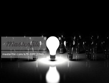 Lightbulbs against a black background.
