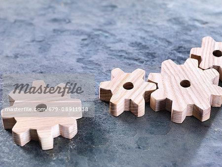 Interlocking wooden cogwheels.