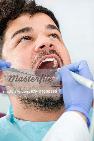 Removing dental tartar.