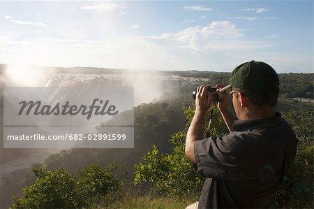 Man admiring falls, Ruacana Falls, Kunene River, Kaokoland, Namibia