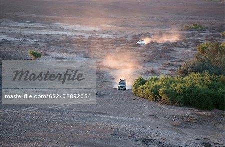 4X4 Vehicles Crossing Desert Landscape
