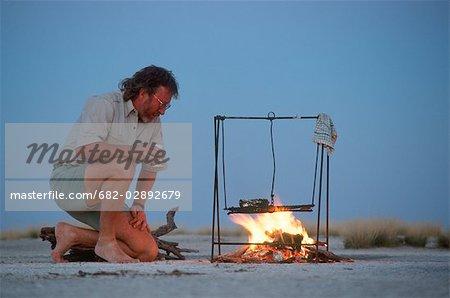 Man Cooking on an Open Fire out on the Makgadikgadi Salt Pans