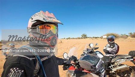 Bikers resting during a road trip, Central Kalahari Desert, Botswana