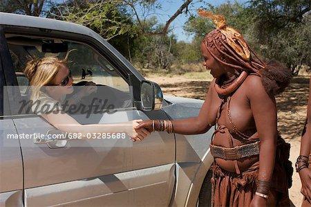 Close Up Of Women Greeting Each Other Epupa Falls Area Kaokoland - 682 area code