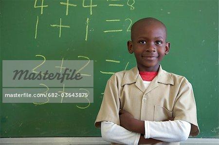 Portrait of a schoolboy at the classroom chalkboard, KwaZulu Nata Province, South Africa