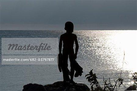 Young boy at sunrise Nkhata Bay, Malawi
