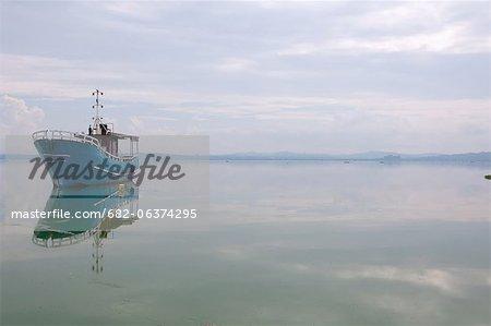 Derelict boat at anchor on Ggaba Beach, Lake Victoria, Kampala, Uganda, East African Union, Africa