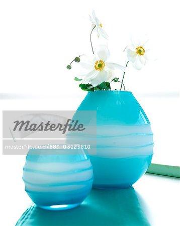 Japanese Anemone In Light Blue Glass Vases Stock Photo