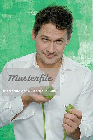 Man holding green plug