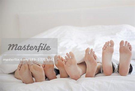 Feet under bedcover