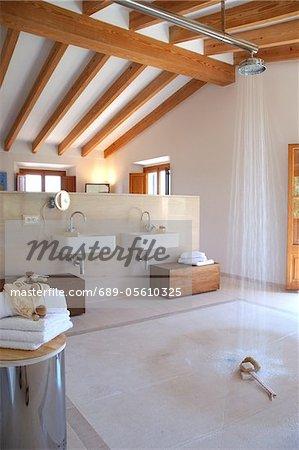 Bathroom with wooden beams