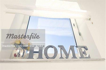 Window with writing home