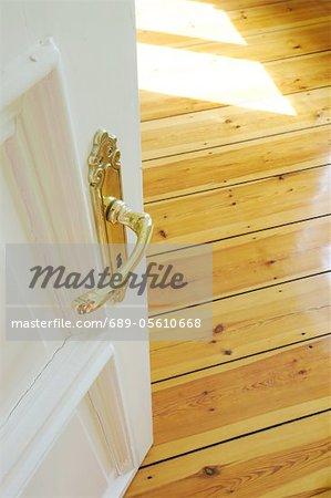 Open door and wooden floor