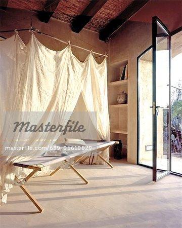 Room with open terrace door