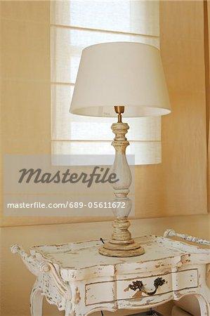 Table lamp on antique dresser
