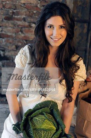 Woman holding savoy cabbage