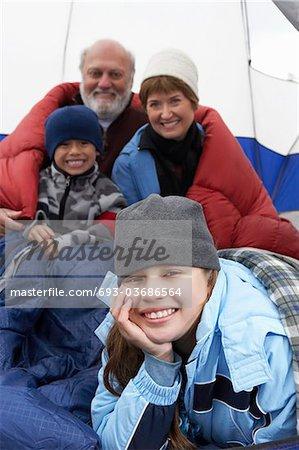 Grandparents and grandchildren (7-12) in tent, (portrait)
