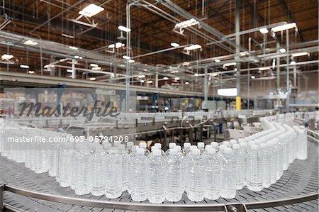 Bottled water on conveyor at bottling plant