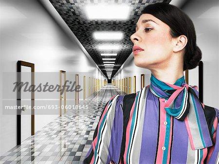 Business woman in front of digital corridor
