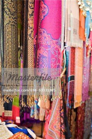 UAE, Dubai, colourful pashminas and fabrics for sale at Bur Dubai souq