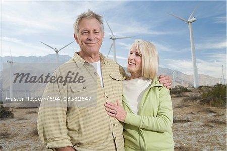 Senior couple near wind farm