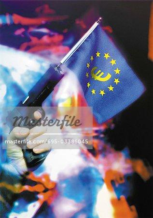 Euro flag coming out of gun barrel.