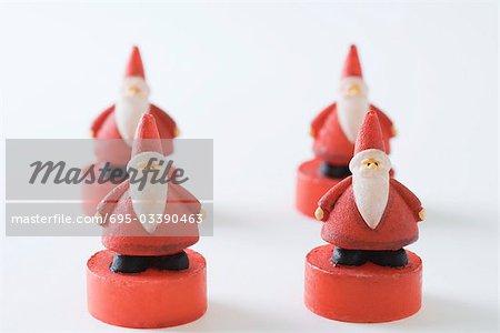 Four Santa Claus figurines